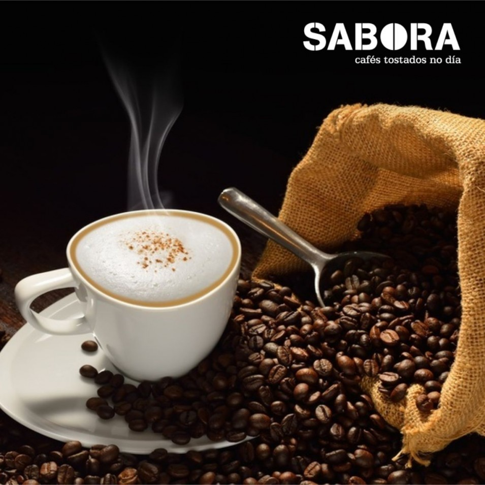 Coffee next to sack with coffee beans