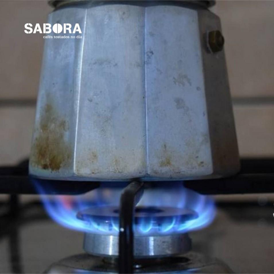 Making coffee at home in Italian coffee maker.